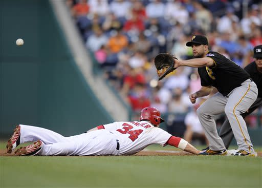 Washington Nationals' Bryce Harper, left, dives back safely to first on a pick-off attempt as Pittsburgh Pirates first baseman Gaby Sanchez, right, awaits the ball during the first inning of a baseball game, Monday, July 22, 2013, in Washington. (AP Photo/Nick Wass)