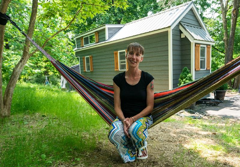 "Brandy Jones, her husband and two sons now live in a tiny home in Reading, Pennsylvania -- she says it makes living ""affordable"" (AFP Photo/Don Emmert)"