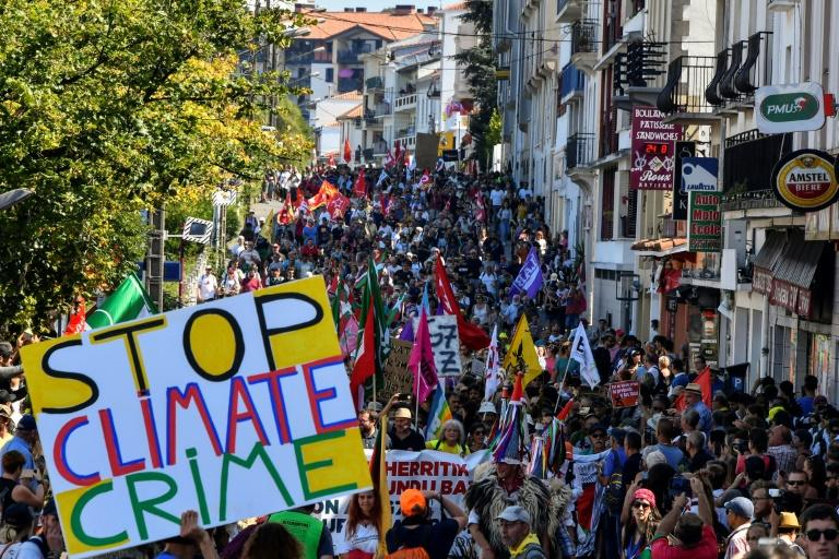 Demonstrators take part in a climate march in Hendaye, south-west France on August 24, 2019, to protest against the annual G7 Summit