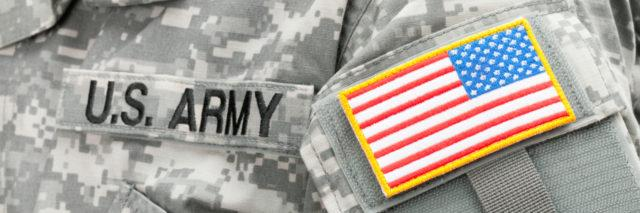 USA flag and U.S. ARMY patch on American soldier's uniform