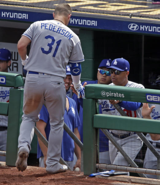 Los Angeles Dodgers' Joc Pederson (31) is greeted by manager Dave Roberts, right, as he returns to the dugout after hitting a solo home run off Pittsburgh Pirates starting pitcher Chris Archer during the sixth inning of a baseball game in Pittsburgh, Sunday, May 26, 2019. (AP Photo/Gene J. Puskar)