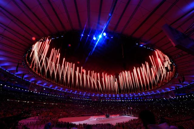 <p>Fireworks explode during the 'Love Sport Tokyo 2020' segment during the Closing Ceremony on Day 16 of the Rio 2016 Olympic Games at Maracana Stadium on August 21, 2016 in Rio de Janeiro, Brazil. (Photo by David Ramos/Getty Images) </p>