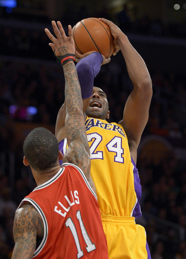 Los Angeles Lakers guard Kobe Bryant, right, puts up a shot as Milwaukee Bucks guard Monta Ellis defends during the first half of their NBA basketball game, Tuesday, Jan. 15, 2013, in Los Angeles. (AP Photo/Mark J. Terrill)