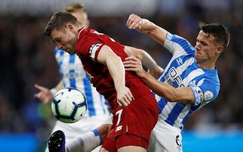 James Milner is lucky not to concede a penalty for handball - Credit: action images