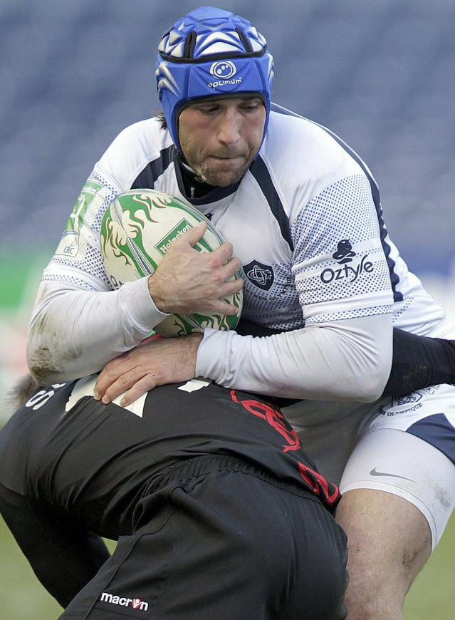 Romain Cabannes (Facing) of French rugby club Castres, is tackled by Ben Cairns of Scottish team Edinburgh during a Heineken Cup, pool one, rugby union match at Murrayfield, Edinburgh, Scotland, on December 20, 2010. The game was postponed Sunday due to bad weather. AFP PHOTO/GRAHAM STUART (Photo credit should read GRAHAM STUART/AFP/Getty Images)