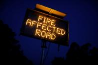 Signage is seen on the bushfire affected Bruthen-Buchan Road near Buchan, Victoria, Australia
