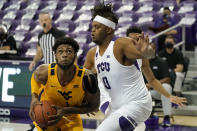West Virginia forward Derek Culver (1) positions for a shot as TCU center Eddie Lampkin, right, defends in the first half of an NCAA college basketball game in Fort Worth, Texas, Tuesday, Feb. 23, 2021. (AP Photo/Tony Gutierrez)