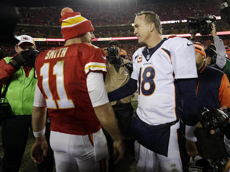 Denver Broncos quarterback Peyton Manning (18) greets Kansas City Chiefs quarterback Alex Smith (11) after an NFL football game, Sunday, Dec. 1, 2013, in Kansas City, Mo. The Broncos won 35-28. (AP Photo/Charlie Riedel)