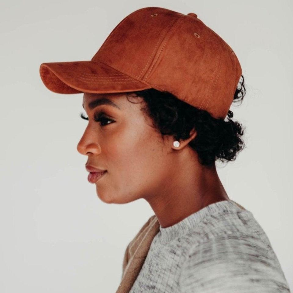 """<h2>Tress Chocolate Faux Suede Cap<br></h2><br>At first glance, you see a hat that'll look good with all the chunky cream-coloured sweaters you ordered online. Correct — but if you look a little closer, you'll find a hat that is fashionable <em>and </em>functional for curly hair. The backstrap of each Tress cap is replaced with three elastic bands so you can put your hair in a ponytail even if you forget a hair tie at home. The inside is covered with satin, which minimises frizz when you take your hat off.<br><br><strong>Tress For Us</strong> Tress Chocolate Faux Suede Cap, $, available at <a href=""""https://tressforus.com/products/chocolate-faux-suede"""" rel=""""nofollow noopener"""" target=""""_blank"""" data-ylk=""""slk:Tress For Us"""" class=""""link rapid-noclick-resp"""">Tress For Us</a>"""