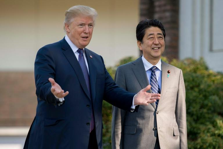 Shinzo Abe (R) says  he will reiterate Tokyo's 'maximum pressure' policy towards Pyongyang in talks with Donald Trump