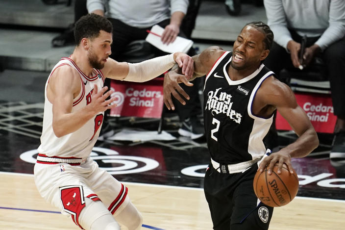 Los Angeles Clippers forward Kawhi Leonard, right, is fouled by Chicago Bulls guard Zach LaVine during the second half of an NBA basketball game Sunday, Jan. 10, 2021, in Los Angeles. (AP Photo/Marcio Jose Sanchez)