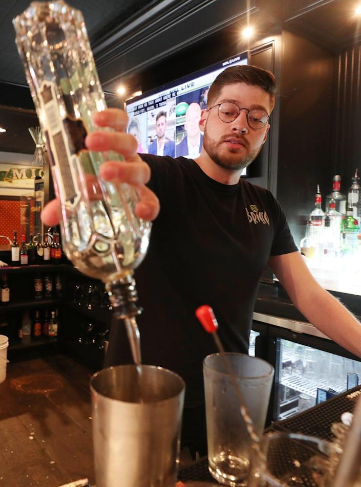 Frank Hodges, a bartender at Pub Bricco in Akron talks about his plans on returning to school to become a Physician Assistant and the state of the food service work on Wednesday June 9, 2021.