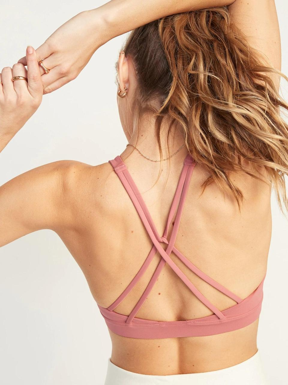 <p>This <span>Old Navy Medium Support Powersoft Strappy Sports Bra</span> ($15-$20, originally $30) stays put through through low-impact activities like barre, and medium-impact exercises, too.</p>