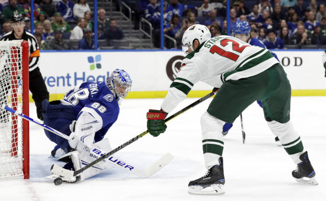 Minnesota Wild center Eric Staal (12) tries to stuff the puck past Tampa Bay Lightning goaltender Andrei Vasilevskiy (88) during the first period of an NHL hockey game Thursday, March 7, 2019, in Tampa, Fla. (AP Photo/Chris O'Meara)
