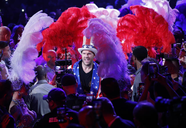 Tyson Fury, of England, enters the arena before a heavyweight boxing match against Tom Schwarz, of Germany, on June 15, 2019, in Las Vegas. (AP Photo/John Locher)