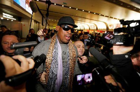 Former NBA basketball player Rodman speaks to the media after returning from his trip to North Korea at Beijing airport