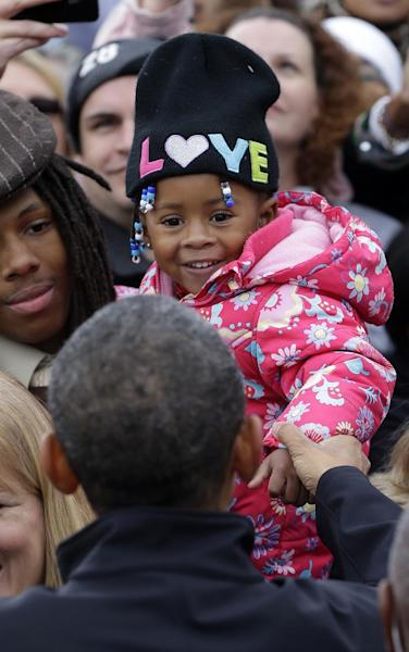 President Barack Obama greets a young supporter during a campaign event at Sloan's Lake Park, Thursday, Oct. 4, 2012, in Denver. (AP Photo/Pablo Martinez Monsivais)