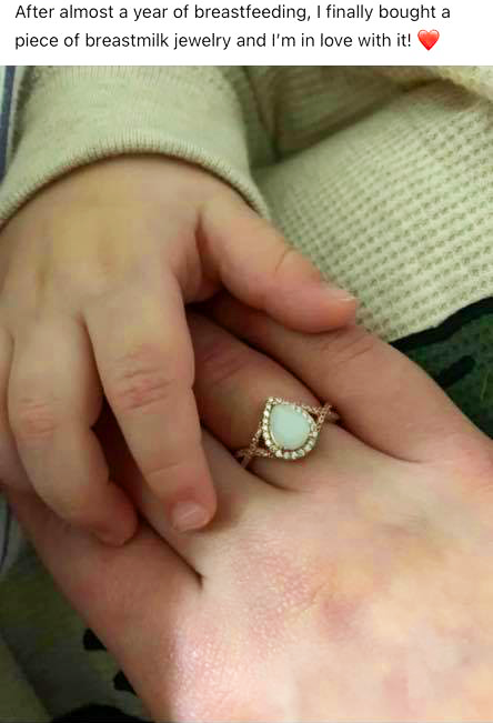 "Facebook post of breast milk ring on middle finger of woman's hand holding baby. Caption: ""After almost a year of breastfeeding, I finally bought a piece of breastmilk jewellery and I'"