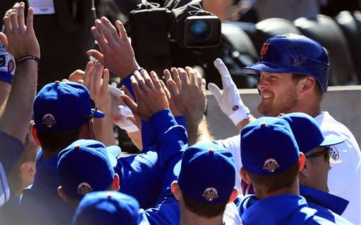 New York Mets' Lucas Duda, right, is congratulated at the dugout after hitting a home run during the seventh inning of a baseball game against the Atlanta Braves, Saturday, April 7, 2012, in New York. (AP Photo/Frank Franklin II)