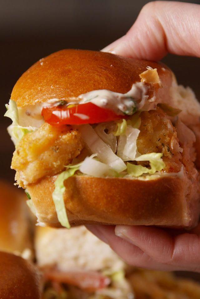 """<p>Celebrate Mardi Gras the right way — with cornmeal-crusted fried shrimp sandwiched between buttery slider buns.</p><p><em><a href=""""https://www.delish.com/cooking/videos/a51284/shrimp-po-boy-sliders-video/"""" rel=""""nofollow noopener"""" target=""""_blank"""" data-ylk=""""slk:Get the recipe from Delish »"""" class=""""link rapid-noclick-resp"""">Get the recipe from Delish »</a></em></p>"""