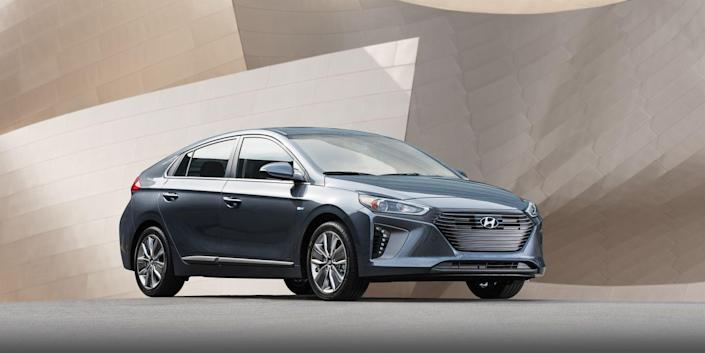 """<p>There is a lot to like about the <a href=""""https://www.caranddriver.com/hyundai/ioniq-2019"""" rel=""""nofollow noopener"""" target=""""_blank"""" data-ylk=""""slk:2019 Hyundai Ioniq hybrid"""" class=""""link rapid-noclick-resp"""">2019 Hyundai Ioniq hybrid</a> (there also are plug-in hybrid and full-electric Ioniq variants). The hatchback delivers 58 mpg on the EPA's combined test cycle in its lowest-priced """"Blue"""" trim, and 55 mpg combined in every other trim. It uses a traditional automatic transmission, which delivers crisp shifts, instead of the slurry weirdness many hybrids' continuously variable automatic transmissions operate with. And the Hyundai looks and feels (mostly) like a conventional hatchback. The buzzy gas-powered engine could be more refined, but that is a common issue among hybrids—so it is hardly a deal breaker.<br></p>"""