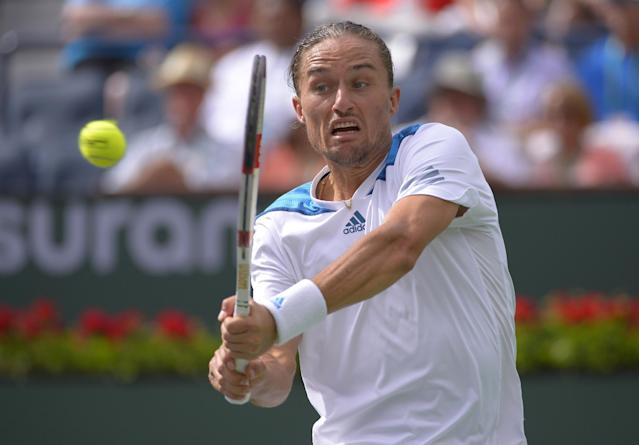 Alexandr Dolgopolov, of Ukraine, hits to Milos Raonic, of Canada, during a quarterfinal match at the BNP Paribas Open tennis tournament, Thursday, March 13, 2014, in Indian Wells, Calif. (AP Photo/Mark J. Terrill)