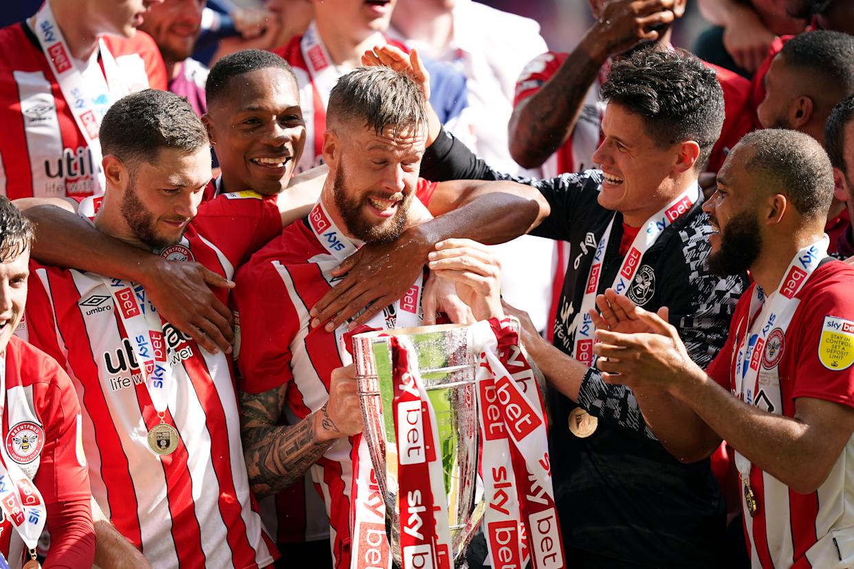 Brentford's Pontus Jansson with the trophy as they celebrate promotion to the Premier League after winning the Sky Bet Championship playoff final at Wembley Stadium, London. Picture date: Saturday May 29, 2021. (Photo by Mike Egerton/PA Images via Getty Images)