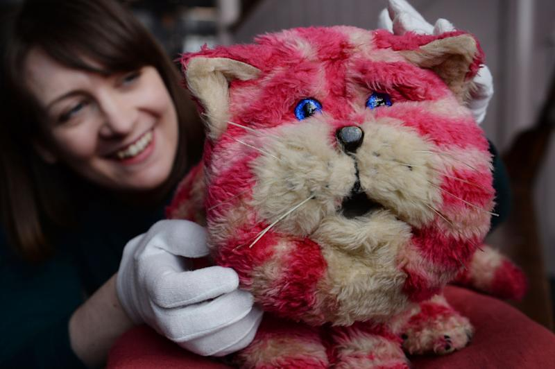 Alice Sage, Curator at the V&A Museum of Childhood in east London with Bagpuss, the original puppet used in the filming of the 1970s children's TV show which has gone on display as part of an exhibition called Clangers, Bagpuss and Co.
