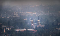 St. Aloysius Church on the campus of Gonzaga University is blanketed in smoke from area wildfires, Saturday, July 10, 2021. (Colin Mulvany/The Spokesman-Review via AP)