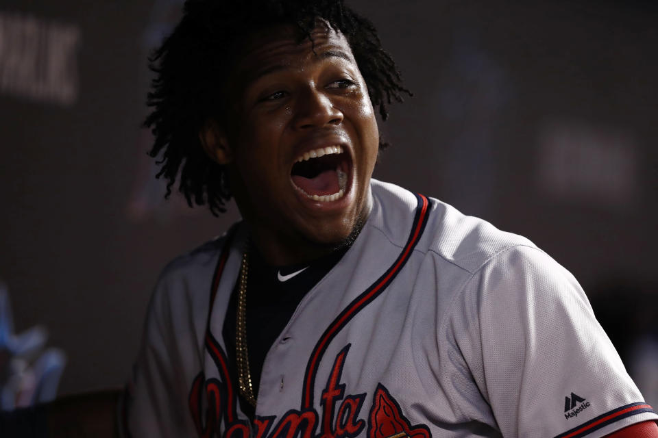 Atlanta Braves' Ronald Acuna Jr. celebrates in the dugout after scoring during the eighth inning of a baseball game against the Miami Marlins, Saturday, Aug. 10, 2019, in Miami. (AP Photo/Brynn Anderson)