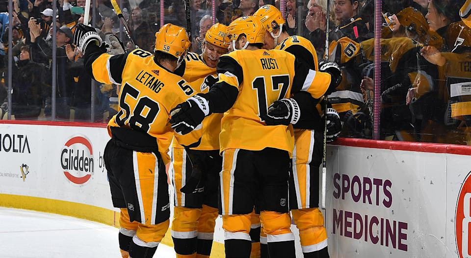 PITTSBURGH, PA - DECEMBER 28: Jake Guentzel #59 of the Pittsburgh Penguins celebrates his goal with teammates during the third period against the Nashville Predators at PPG PAINTS Arena on December 28, 2019 in Pittsburgh, Pennsylvania. (Photo by Joe Sargent/NHLI via Getty Images)