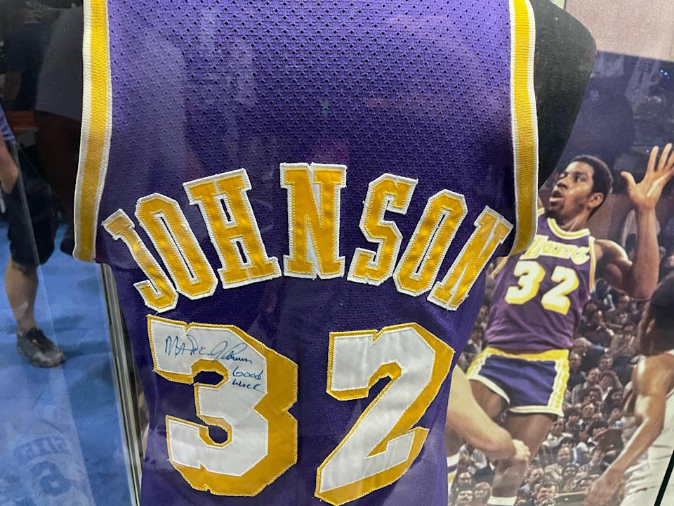 This 1980 Finals game-worn Magic Johnson jersey, displayed at The National, could fetch more than $600,000 at Heritage Auctions. (Eric Edholm/Yahoo Sports)