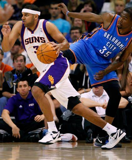 Phoenix Suns forward Jared Dudley drives past Oklahoma City Thunder forward Kevin Durant (35) during the first half of an NBA basketball game, Wednesday, April 18, 2012, in Phoenix. (AP Photo/Matt York)