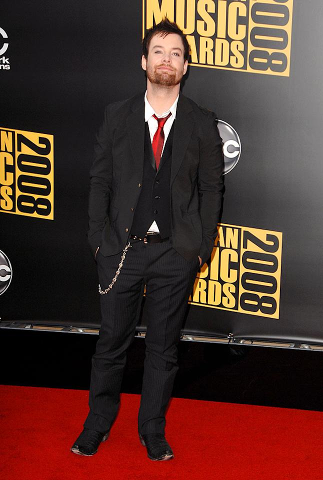 """American Idol"" winner David Cook looked confident and comfortable in his basic black suit, which he accessorized with a red tie and wallet chain. Steve Granitz/<a href=""http://www.wireimage.com"" target=""new"">WireImage.com</a> - November 23, 2008"