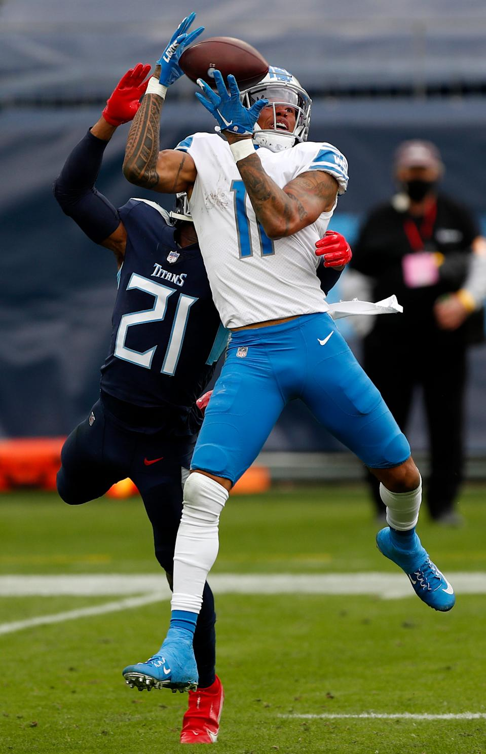 Wide receiver Marvin Jones (11) of the Detroit Lions makes a reception over cornerback Malcolm Butler (21) of the Tennessee Titans during the second quarter of the game at Nissan Stadium on Dec. 20, 2020 in Nashville, Tennessee.