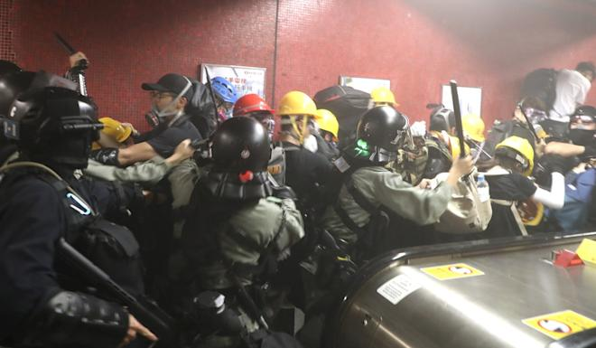 Chaos in Tai Koo MTR station as police storm in. Photo: Handout