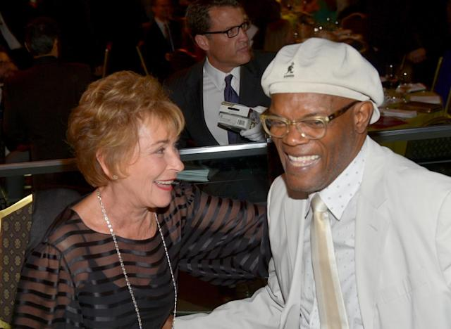 Judge Judy and Samuel L. Jackson sharing a laugh. (Photo: Getty Images)