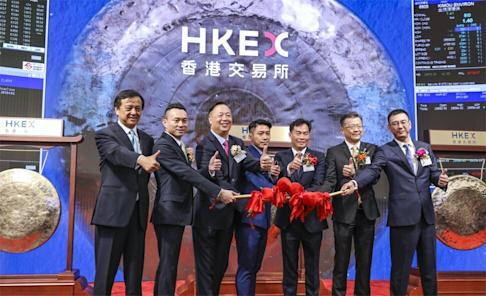 HKEX chief executive Charles Li (extreme left) posing with executives on one of the busiest days on July 16, 2019 when six companies made their listing debuts. Photo: Nora Tam