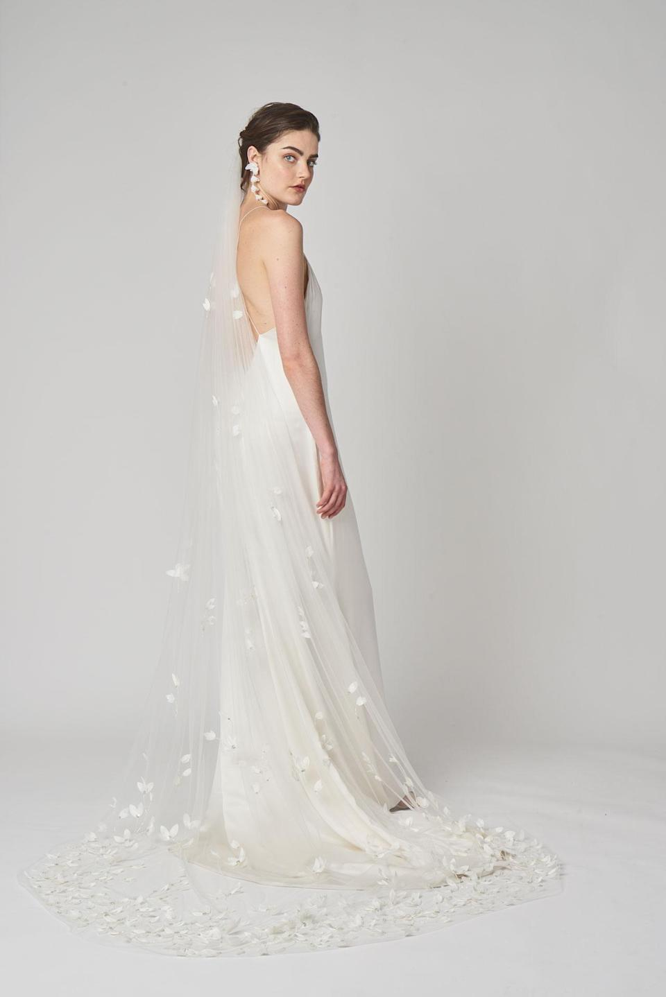 <p>Long veil and simple white dress. (Photo: Courtesy of Alexandra Grecco) </p>