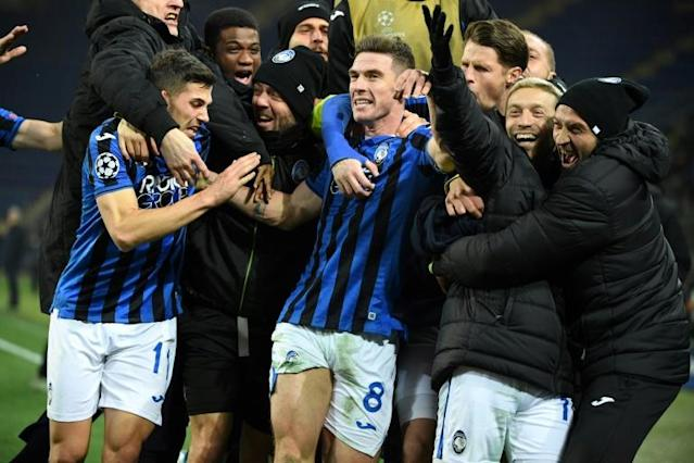 Atalanta famously qualified for the last 16 (AFP Photo/Sergei SUPINSKY)