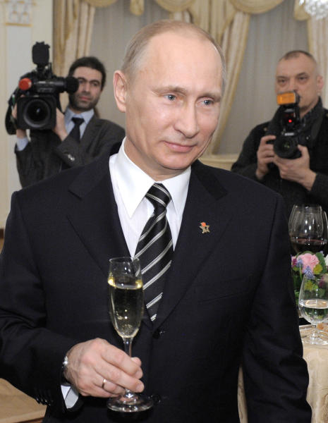 Russian Prime Minister Vladimir Putin toasts during a meeting with his supporters in Moscow, Monday, March 5, 2012. Putin won more than 63 percent of the vote according to the nearly complete official returns. (AP Photo/RIA-Novosti, Alexei Druzhinin, Government Press Service)