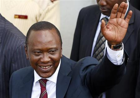 President-elect of Kenya Uhuru Kenyatta waves to his supporters in front of a church in his hometown Gatundu