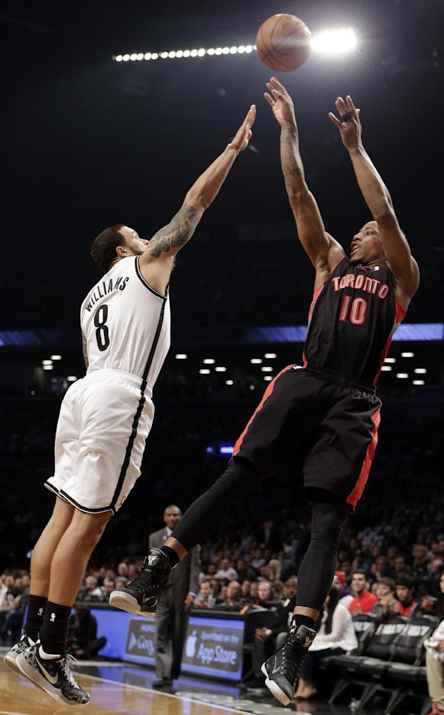 Toronto Raptors' DeMar DeRozan (10) shoots over Brooklyn Nets' Deron Williams (8) during the first half of Game 3 of an NBA basketball first-round playoff series Friday, April 25, 2014, in New York. (AP Photo/Frank Franklin II)