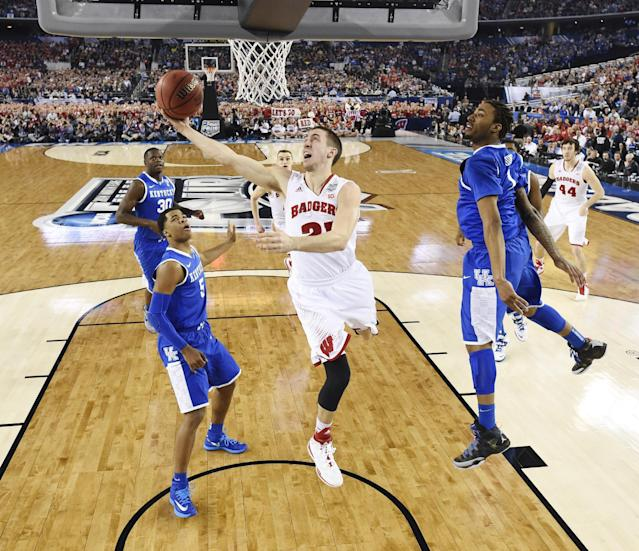Wisconsin guard Josh Gasser (21) shoots against Kentucky during the first half of the NCAA Final Four tournament college basketball semifinal game Saturday, April 5, 2014, in Arlington, Texas. (AP Photo/Chris Steppig, pool)