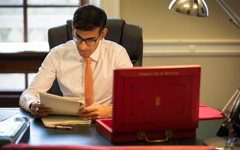 The Chancellor of the Exchequer, Rishi Sunak, prepares for his first Budget speech in his office in the Palace of Westminster in March - HM Treasury/PA