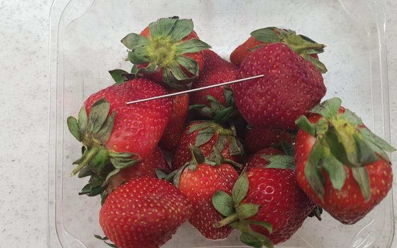 Australian police arrest woman for putting needles in strawberries