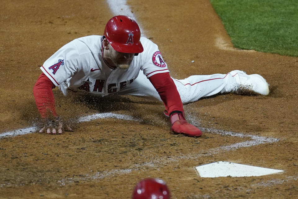 Los Angeles Angels' Taylor Ward slides in to home to score off of a hit by David Fletcher during the fifth inning of a baseball game against the Seattle Mariners Saturday, June 5, 2021, in Anaheim, Calif. (AP Photo/Ashley Landis)