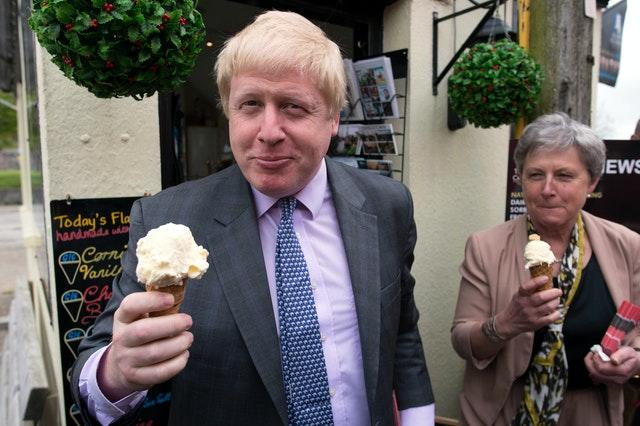 Boris Johnson eating an ice cream in Cornwall (Stefan Rousseau/PA)