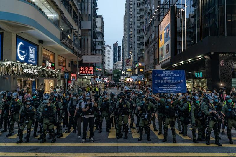 Riot police put up an warning flag during an anti-government protest on September 6, 2020 in Hong Kong, China.
