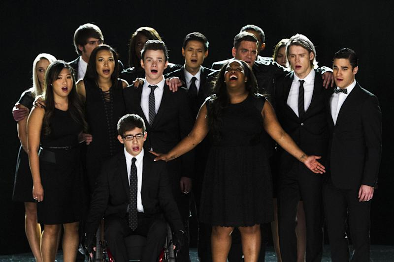 """This photo released by Fox shows the McKinley family of the past and present joining together to remember and celebrate the life of Finn Hudson, paying tribute also to the late actor Cory Monteith who played him, in """"The Quarterback"""" episode of """"Glee,"""" which aired Oct. 10, 2013. """"Glee"""" hit the right note as it leads with eight nominations for the People's Choice Awards. Broadcast on CBS, The People's Choice Awards will be presented Wednesday, Jan. 8, 2014. (AP Photo/Fox, Adam Rose)"""